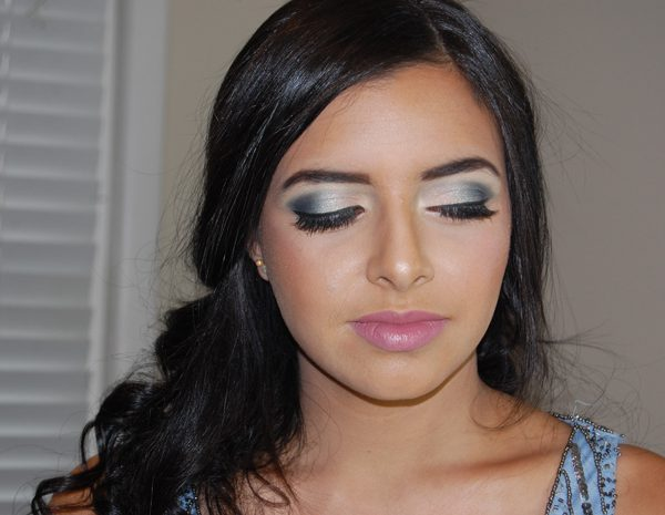 Bold prom makeup, accentuating the eyes, for this beautiful senior.