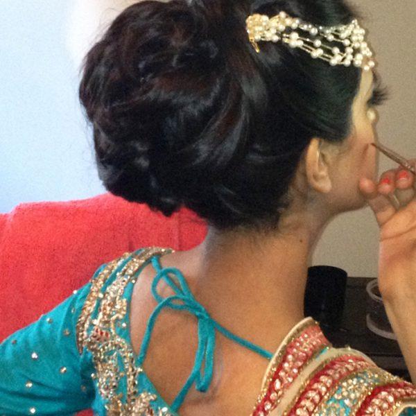 A hair bun full of volume for this bride