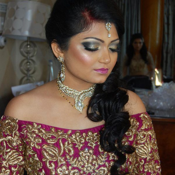 Beautiful bride with her reception look at Chateau Briand - bridal hair and makeup by Naz Beauty