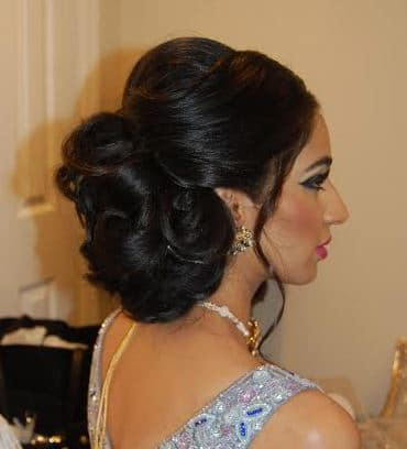 Beautiful bridal updo for this Indian bride's wedding reception at Leonard's Palazzo in Great Neck, NY - hair and makeup by Naz Beauty