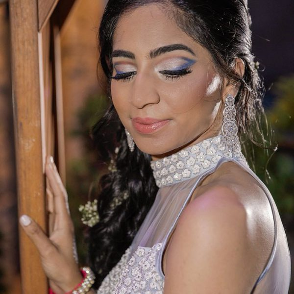 Bold glam cut crease makeup at this bride's sangeet night in Antun's at Hicksville, NY - bridal makeup and hair by Naz Beauty