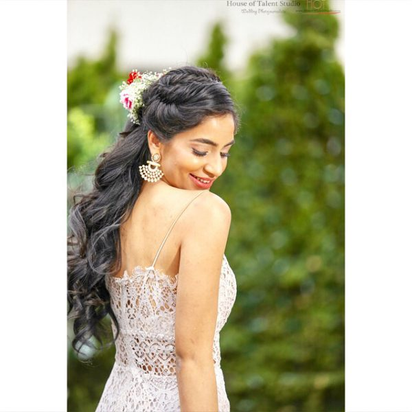 Fairy tale like braids flowing into loose waves at this bride's bridal shower at Akbar in Garden City, NY