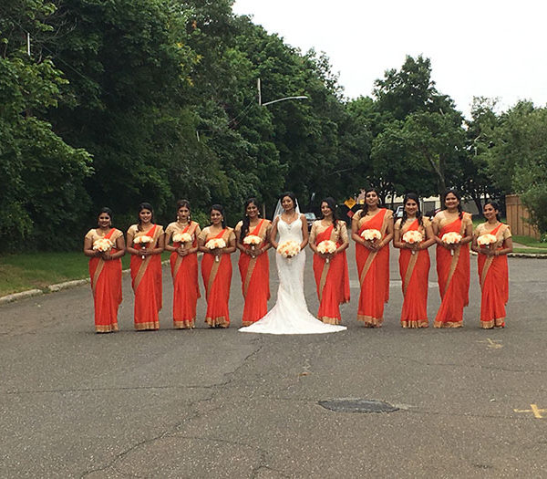 Bride and her bridal parties with orange saris