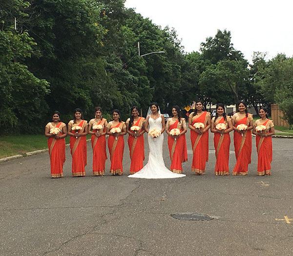 Bride and her bridal parties with orange saris