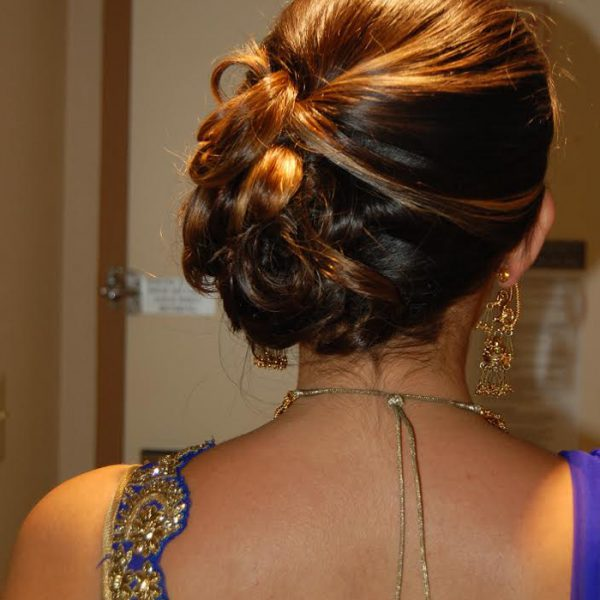 Side bun for this sister of the groom - wedding party hair and makeup by Naz Beauty