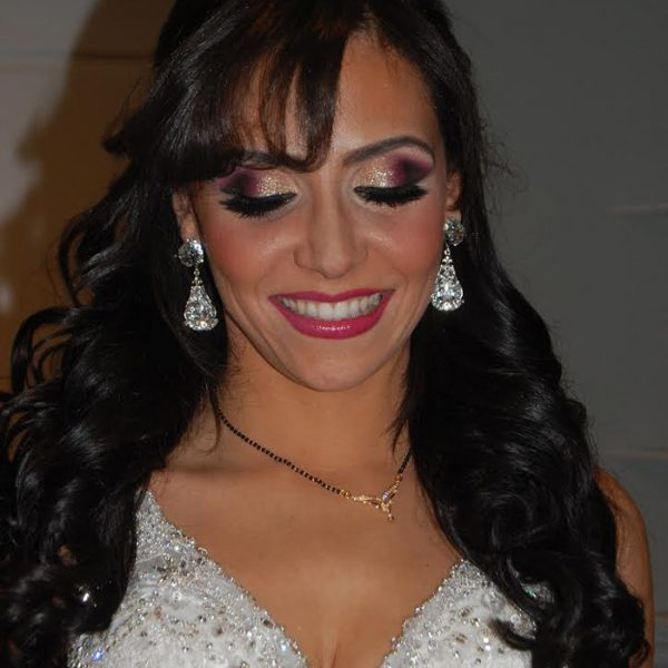 An extra bold dazzle on the eyes of this bride with glitter at her wedding reception at  the Palace in Somerset, NJ - bridal makeup and hair by Naz Beauty