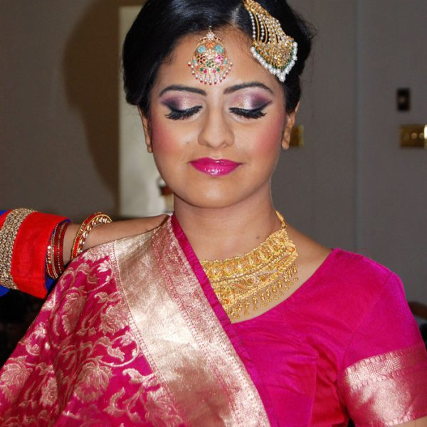 Bold makeup goes well with this sari at this bride's reception in Edgmont Contry Club in Edgemont, PA - bridal makeup and hair by Naz Beauty