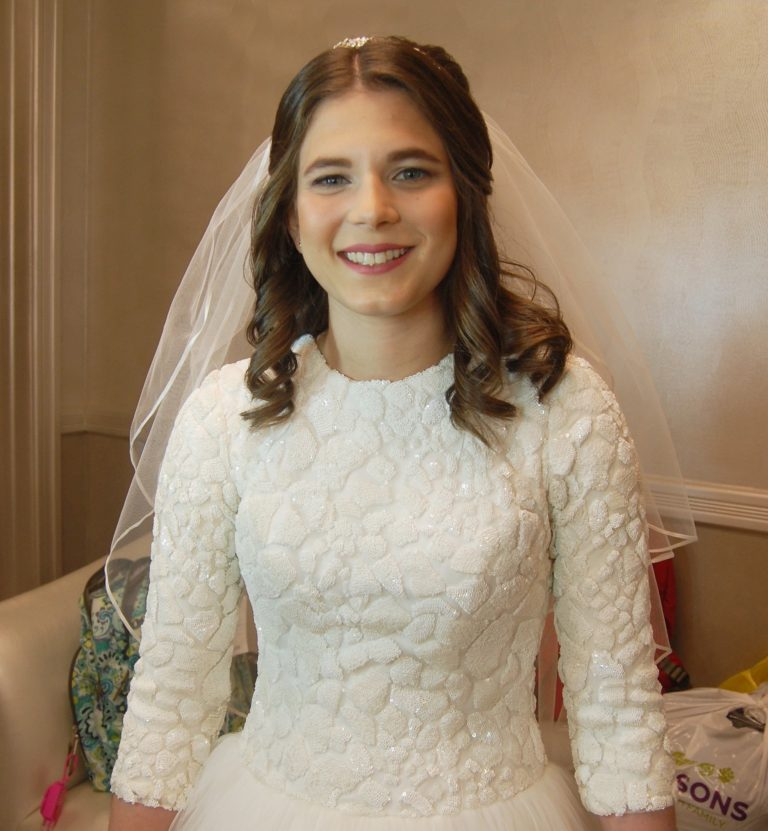 Stunning with simple makeup, our bride at the Sands Atlantic Beach - bridal hair and makeup by Naz Beauty